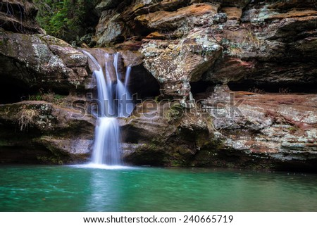 Waterfall along the Old Mans Cave trail in Hocking Hills, Ohio. - stock photo