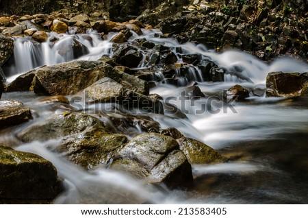 Waterfall and blue stream - stock photo