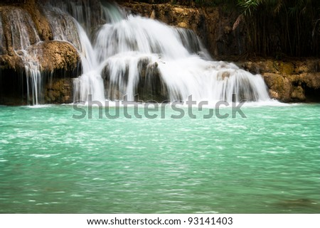 Waterfall and blue stream in the forest Laos - stock photo