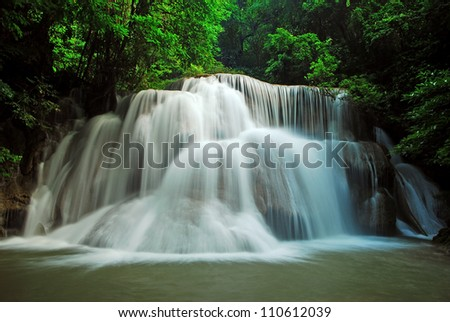 Waterfall and blue stream in the forest Thailand nature background for design - stock photo