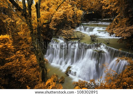 Waterfall and blue stream in the yellow forest Thailand - stock photo