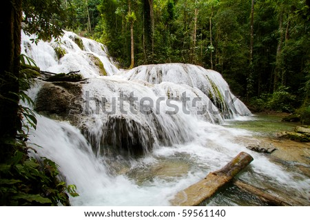 Waterfall and pool, natural beautiful paradise in the forest - stock photo