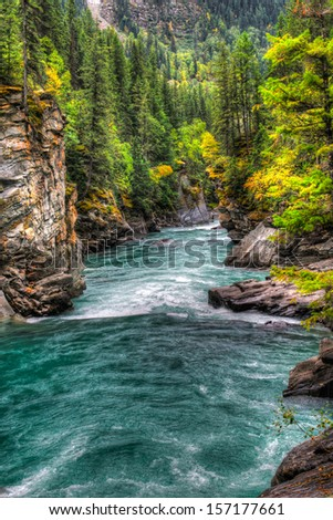 Waterfall and river views of the scenic Frasier River, Mount Robson Provincial Park, British Columbia Canada - stock photo