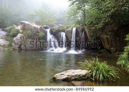 waterfall and stream into the black dragon pool in lushan,China - stock photo