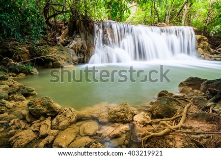 waterfall and tree root in Thailand National Park.