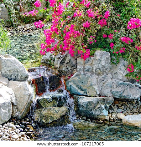 Waterfall and tropical garden in patio spa - stock photo
