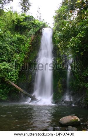 Waterfall at Base of Mount Kilimanjaro - stock photo