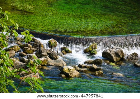 Waterfall at Fontaine de Vaucluse (Provence, France) in sunny day.   - stock photo
