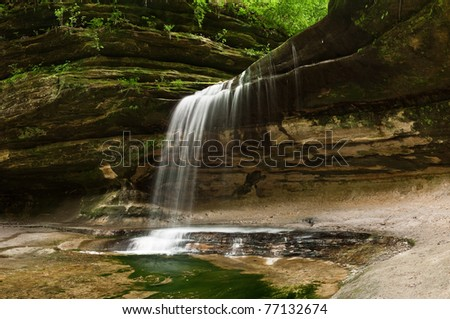 Waterfall at the and of LaSalle Canyon in Starved Rock State Park, Illinois. - stock photo