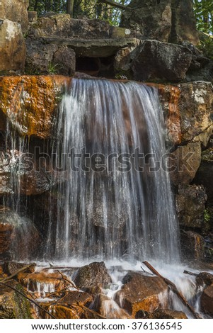 Waterfall at the casino park in spring, Georgsmarienhuette, Osnabrueck country, Lower Saxony, Germany, Europe - stock photo