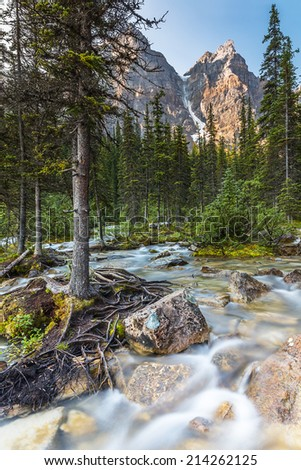 Waterfall at the far end of the Moraine Lake in the banff national park canda - stock photo