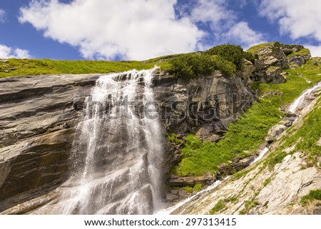 Waterfall at the Grossglockner High Alpine Road in the European Alps, Austria. This famous road was built in the 1930th. The Grossglockner High Alpine Road was opened 1935. - stock photo
