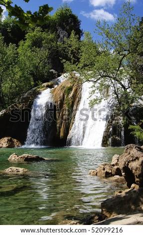 Waterfall at the lake - stock photo