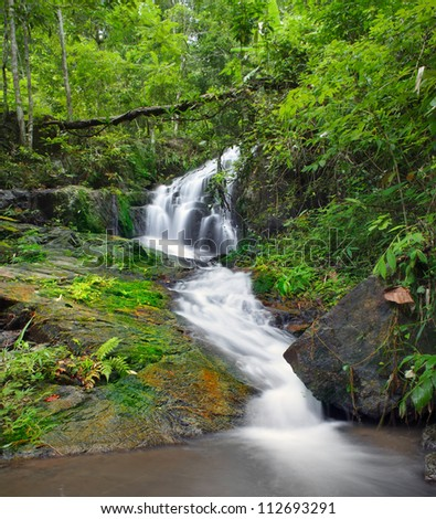Waterfall background in jungle forest - stock photo