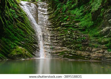 Waterfall. Beautiful waterfall landscape. Waterfall in forest. Sochi, Russia - stock photo