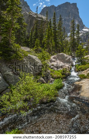 Waterfall cascade along the hiking trail to Emerald Lake view on Hallett Peak-Rocky Mountain Colorado - stock photo