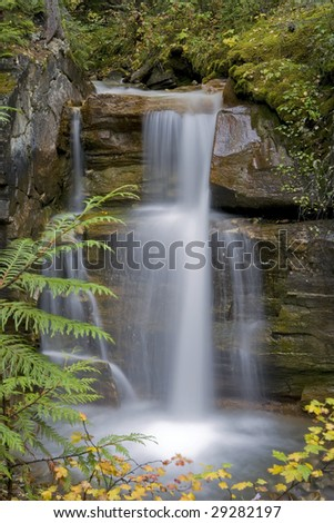 Waterfall cascading a 15 foot rock face