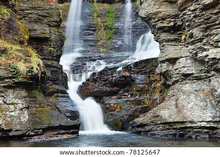 Waterfall closeup with rocks in Autumn. From Fulmer Falls Pennsylvania Dingmans Falls. - stock photo