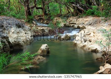 Waterfall Creek in summer forest in Kanchanaburi Thailand - stock photo