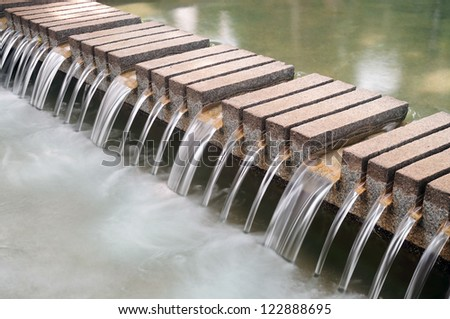 Waterfall decorate structure in the park. - stock photo
