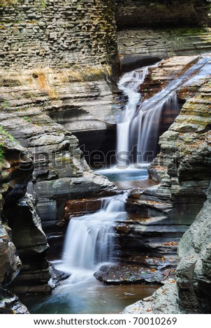 waterfall details in woods with rocks and stream in Watkins Glen state park in New York State - stock photo
