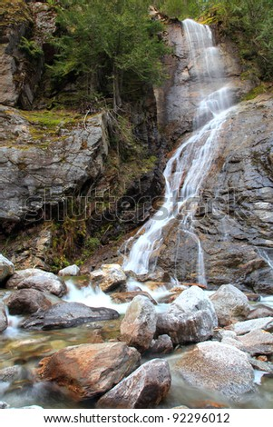 Waterfall Down Rock Face - stock photo