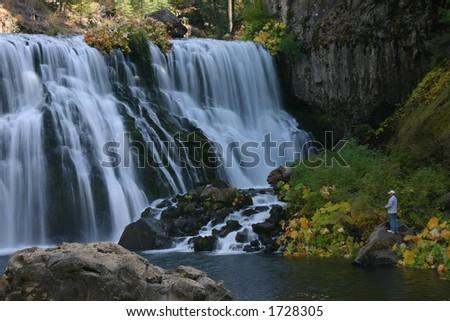 Waterfall Fisherman - stock photo
