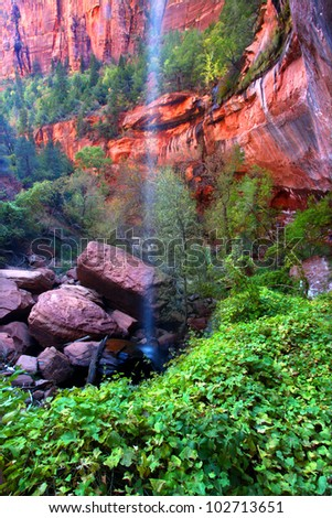Waterfall flows into the Lower Emerald Pools of Zion National Park in Utah - stock photo