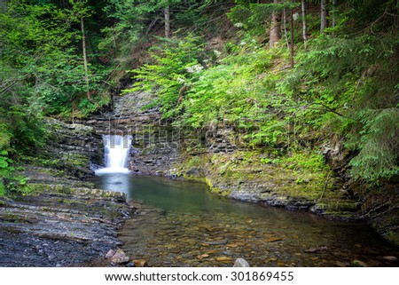 Waterfall from ravine. Cascading Water. - stock photo