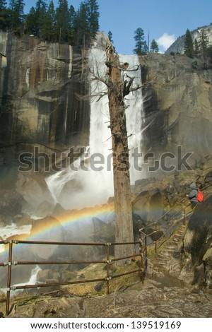 Waterfall in a forest, Yosemite Mist Trail, Vernal Falls, Yosemite National Park, California, USA - stock photo