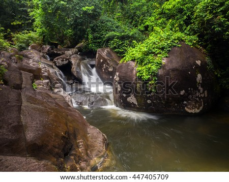Waterfall in a lush rainforest. Photographed at the Khao Cha Mao Falls in the National Park in Rayong. Thailand - stock photo