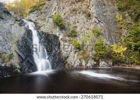 Waterfall in a mountain creek in the High Fens, Ardennes, Belgium with rotating vortex, long exposure shot - stock photo