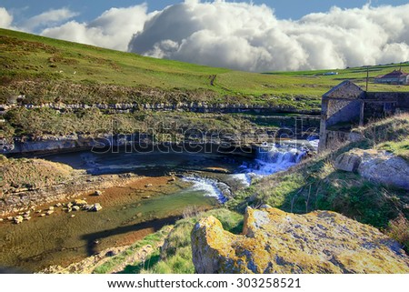 waterfall in a steep meadow - stock photo
