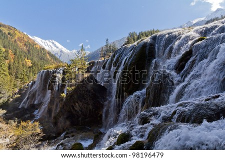 Waterfall in a sunny day - stock photo