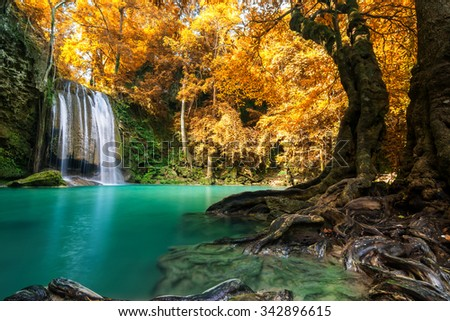 Waterfall in autumn forest at Erawan waterfall National Park, Thailand  - stock photo