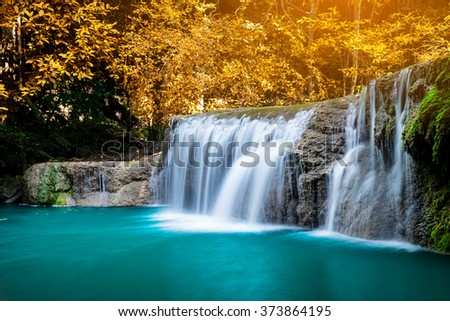 Waterfall in colorful autumn forest at Erawan waterfall National Park, Thailand  - stock photo