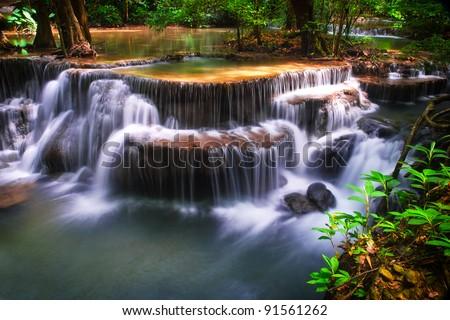 waterfall in deep forest at huay mae ka min of Karnjanaburi in Thailand - stock photo