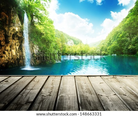 waterfall in deep forest of croatia and wood pier - stock photo