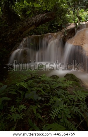 Waterfall in deep forest of Northern Thailand.