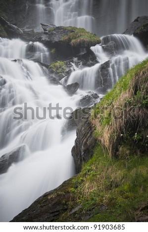 waterfall in deep forest of Valle D'Aosta, Italy. - stock photo