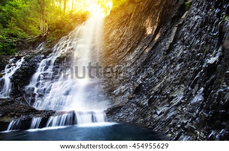 Waterfall in deep moss forest, clean and fresh in Carpathians, Ukraine. - stock photo