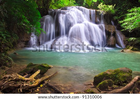 Waterfall in deep perfect green forest - stock photo