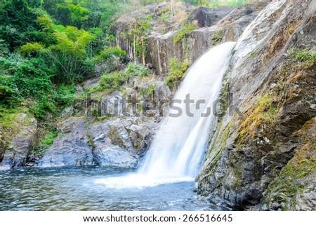 Waterfall in deep rain forest. - stock photo