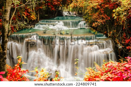 Waterfall in deep rain forest jungle. (Huay Mae Kamin Waterfall in Kanchanaburi Province, Thailand) - stock photo