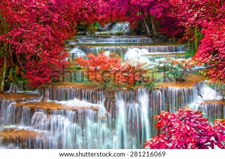Waterfall in deep rain forest jungle. (Huay Mae Kamin Waterfall in Kanchanaburi Province, Thailand) - stock photo