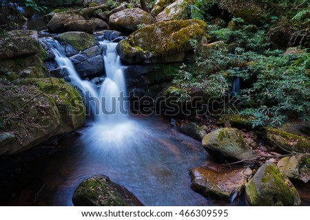 Waterfall in evergreen forest in north of Thailand