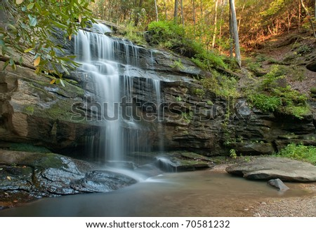 Waterfall in Fall Waterfall in the Blue Ridge Mountains of North Carolina during autumn. - stock photo