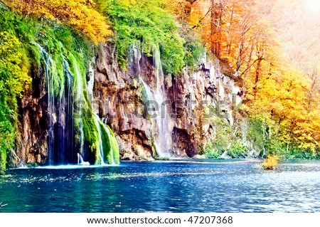 waterfall in forest, autumn - stock photo
