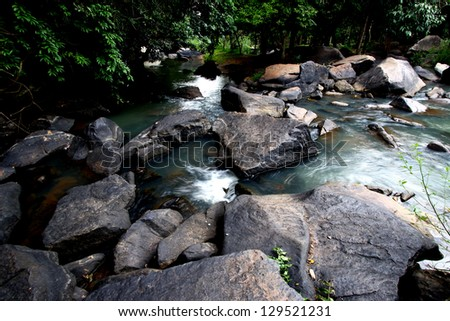 Waterfall in forest & stone