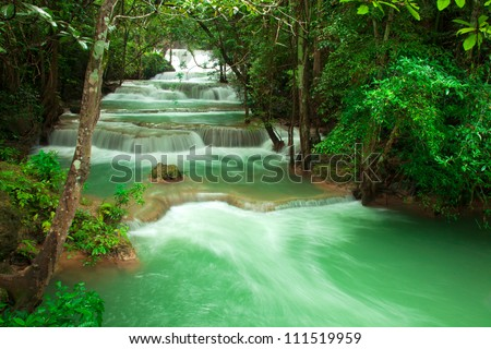 waterfall in fresh green forest  Thailand - stock photo